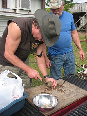 Randy learns to shuck an oyster